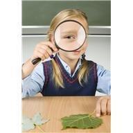 school girl w leaf and mag glass