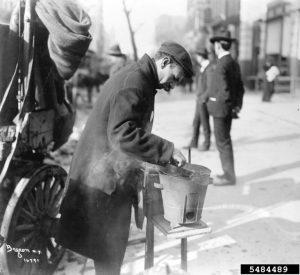 Caption: Street vendor roasting chestnuts (USDA).